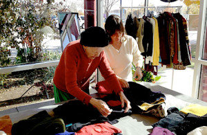 One of our Alzheimer's guests and SOC staff browsing though the Women's Boutique.