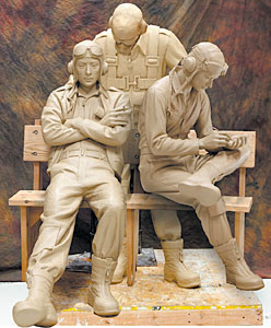 Frenchy, middle figure of the three, depicts a spirit of a pilot already killed in action. He wears the clothes and equipment he wore when he was killed - parachute, gloves, helmet, goggles and oxygen mask. Like the countless young men he represents, we cannot see any part of him. We will never know him. He is lost to us forever. Yet through his death, the still living pilots learn lessons that help them survive combat.