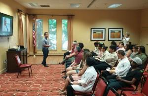 SAGE trainer Reynaldo Mireles presents LGBT sensitivity training to associates of Harvard Square.
