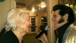 Local Elvis impersonator Dennis Thornberry croons to Juniper Village resident Sophie Szillosi at a celebration remembering Elvis Presley on his 83rd birthday.