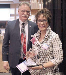 President of the Community Reach Center Foundation Board John Parker and Donna Alengi, 2019 Mary Ciancio Memorial Distinguished Service Award recipient