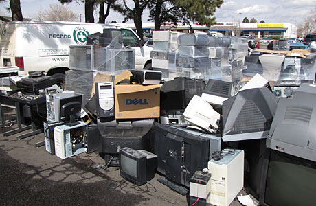 Electronic items piled high at the electronic recycling event.