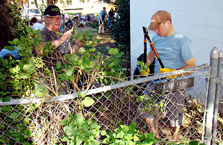 Local rocket scientists picked up paint brushes, rollers and garden tools on Aug. 16 to spruce up the home of a 97-year-old veteran and Pearl Harbor survivor.
