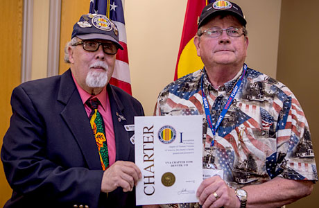 """Manuel """"Manny"""" Pedraza, left, President, Colorado VVA State Council and President, VVA Chapter 1075 (Colorado Springs), presents the national charter to Lee White, President of the new VVA Chapter 1106 South Metro Denver at the new chapters monthly meeting on Feb. 7, 2015."""