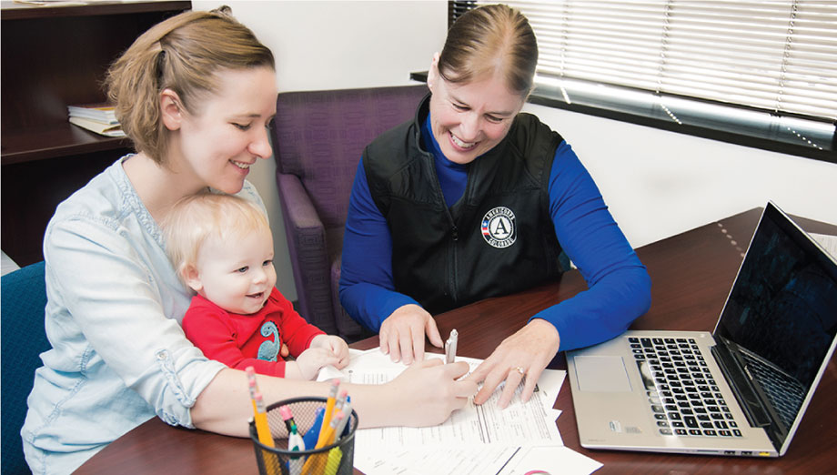 AmeriCorps Encore member Tamara Weil helps a young family connect to needed services.
