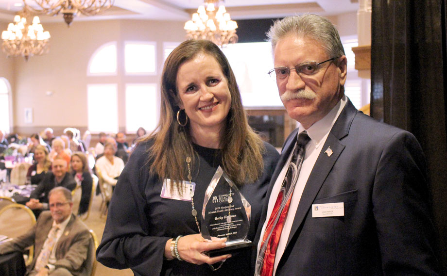 Becky Hoffman, 2019 Marjory Ball Mental Health Advocacy Award and John Parker, president of the Community Reach Center Foundation Board